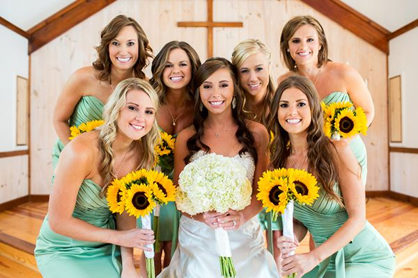 Bridesmaids in Spring Green with Sunflowers! | Cariad Photography | See More: http://heyweddinglady.com/spring-green-southern-wedding-with-a-travel-theme/