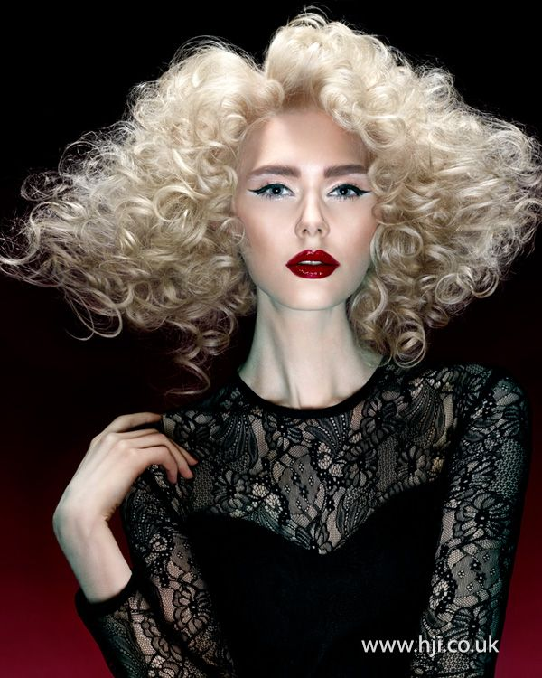 2015 tight blonde curly hairstyle with volume.jpg