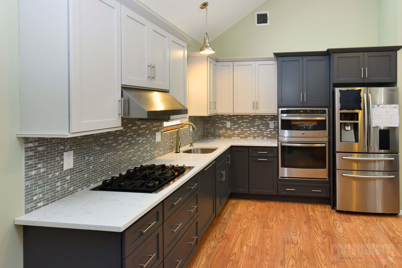 Shiloh Select Poplar Cabinets In Heatherstone And Countertops In Silestone Mediteranean Kitchen Design Installing Kitchen Cabinets Kitchen Remodel