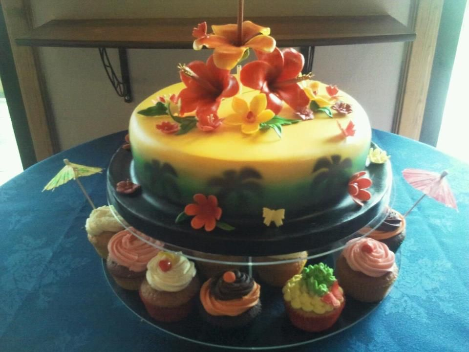 A jamaican rum wedding cake hand crafted hibiscus flowers
