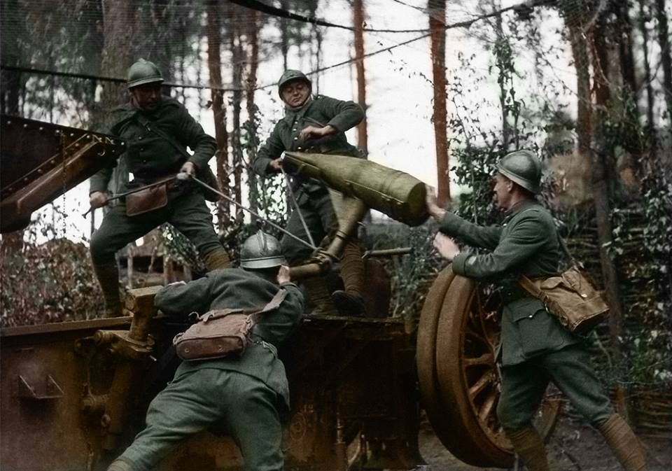 French soldiers load a piece of artillery in a wood somewhere in the Western Front on May 29, 1940. The shell will be fired into the Nazi-occupied sector of the soldiers' homeland.