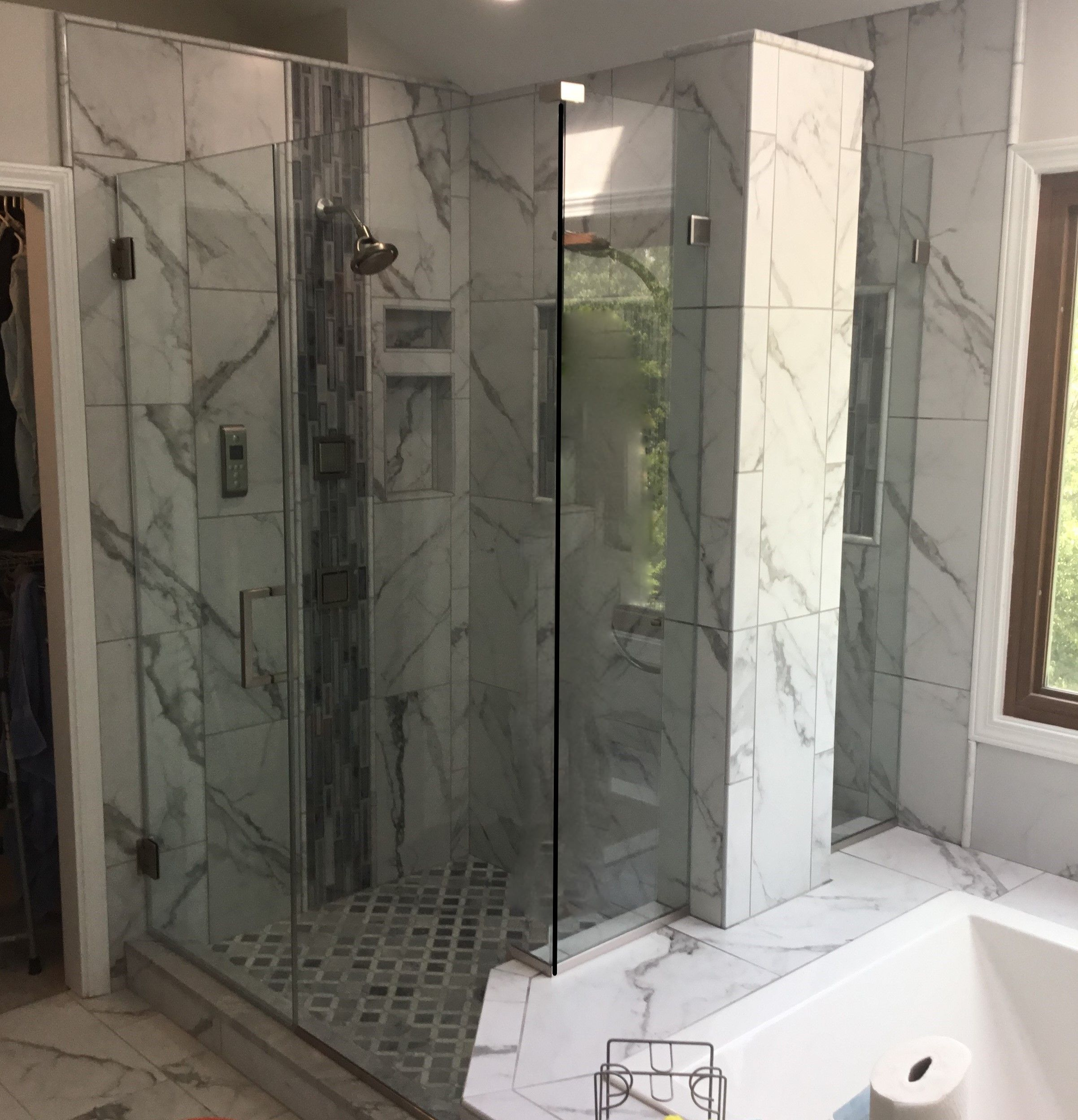 A Custom Frameless Shower Enclosure With Separate Fixed Panel