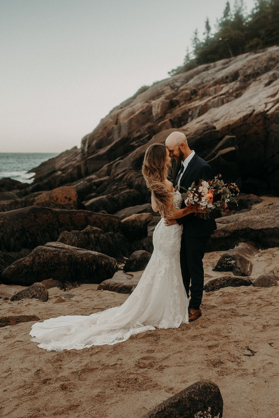 A beautiful Maine elopement in Acadia National Park. Boho Bride with wildflower bouquet. Keep your wedding intimate and COVID-free with our Maine Elopement Collective Packages. Click to read more! #mainewedding #elopement