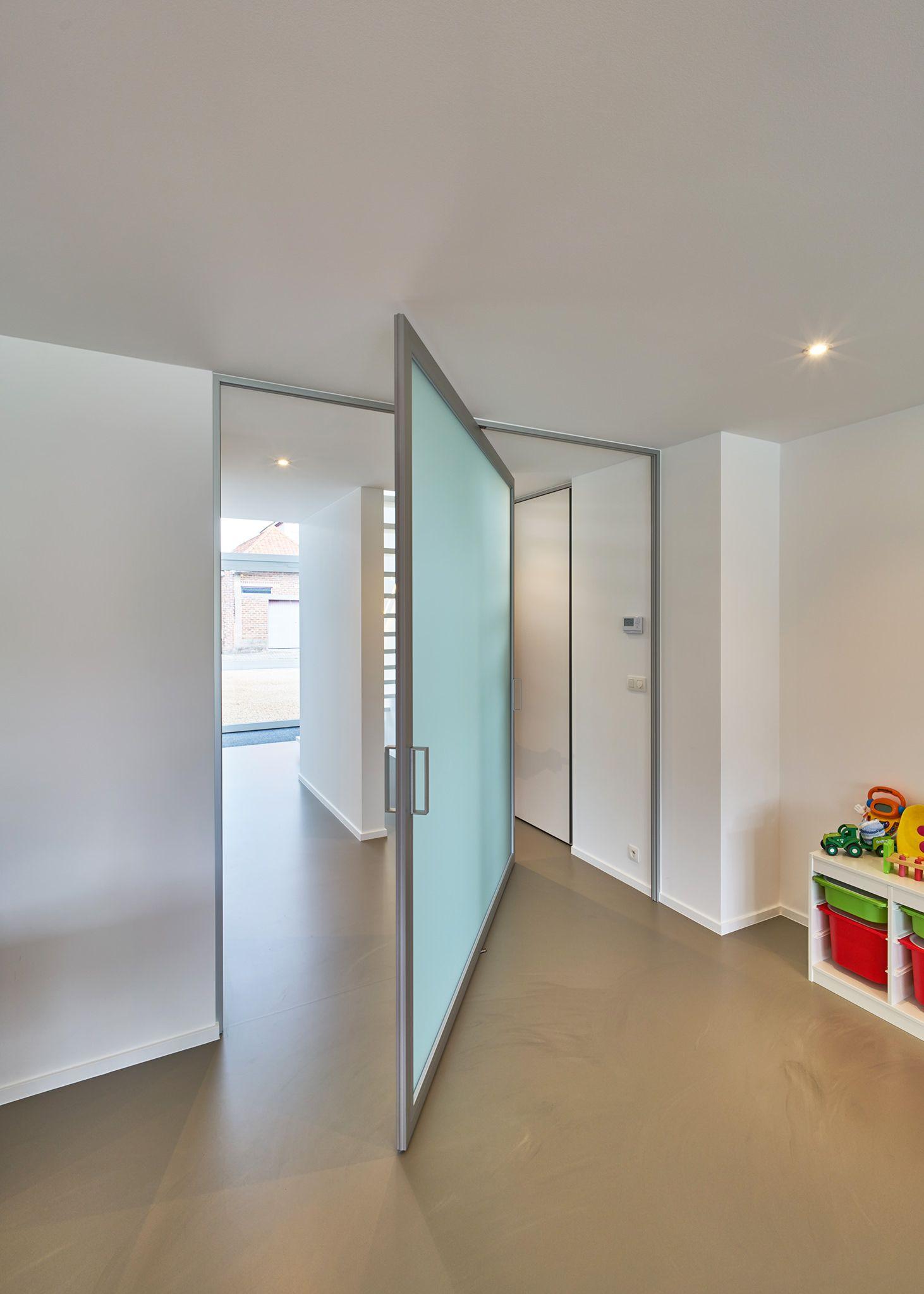 pivot hinge closet door. matte glass pivot door with central axis pivoting hinge. hinge closet