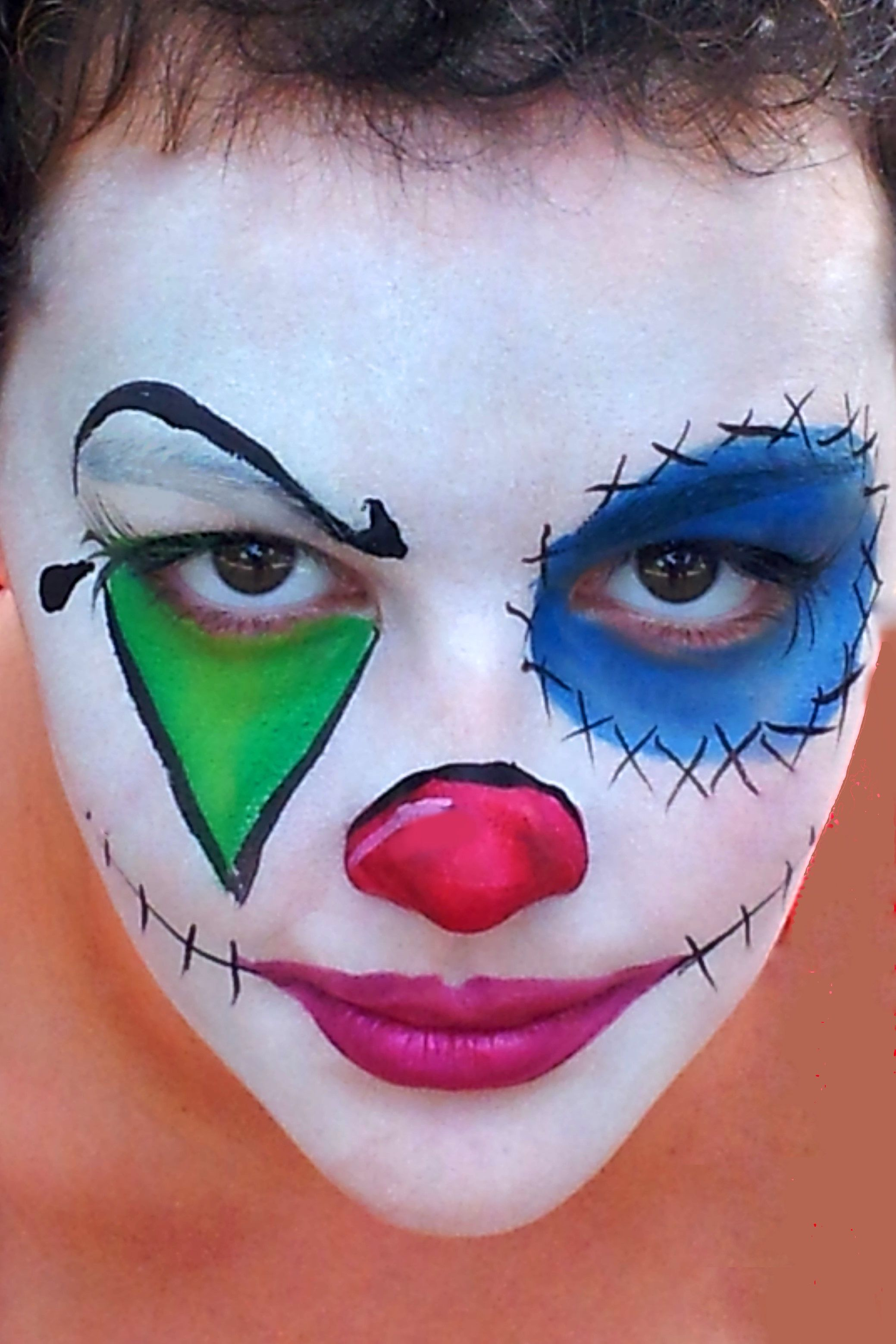 scary creepy clown face paint for halloween party or event white background is starblend white powder colors in design are tag