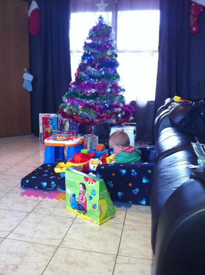 Little Cody playing with all his presents christmas night 2012