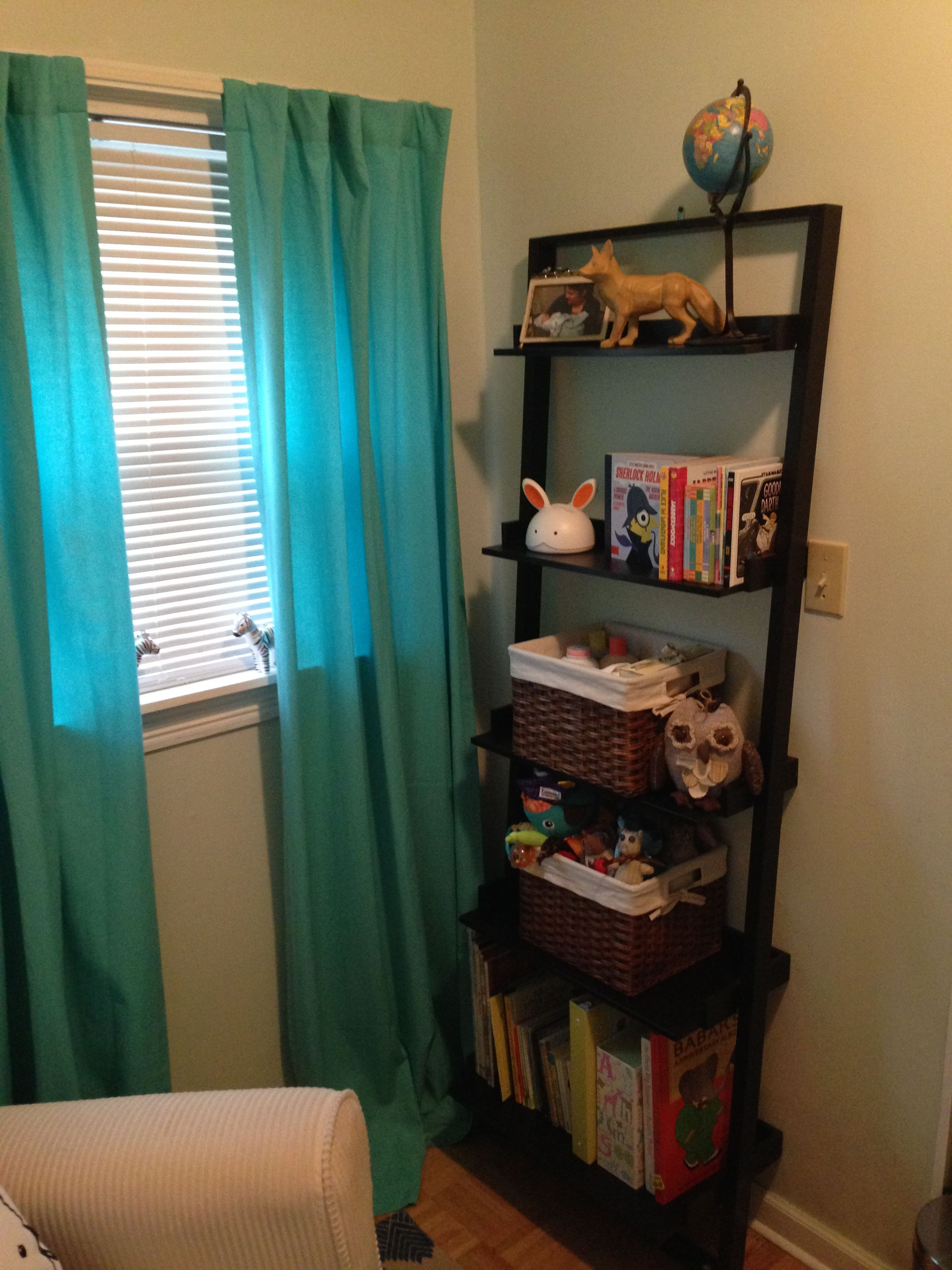 No closet in the nursery ud ladder bookshelf with baskets for bibs