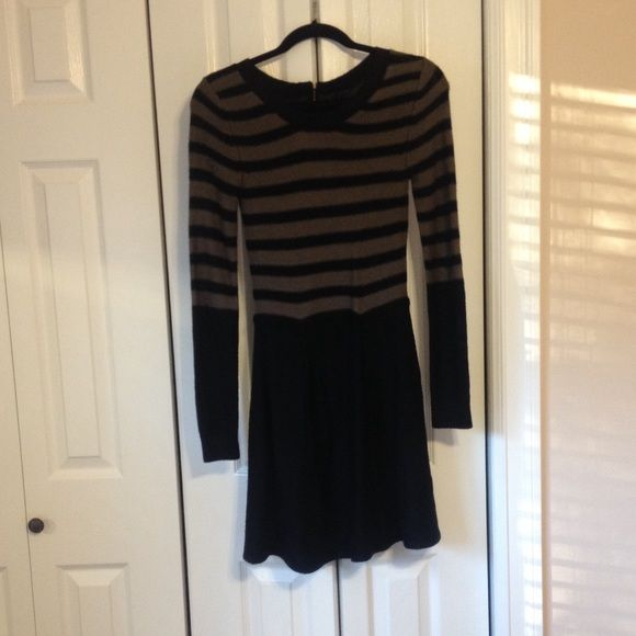 Sweater Dress Sweater dress perfect for winter! Has a slip underneath so the material does not bother you by being itchy. Long sleeves and is about knee length. Size Small. Received as gift but never even worn (too big) so it is basically bran new! Dresses