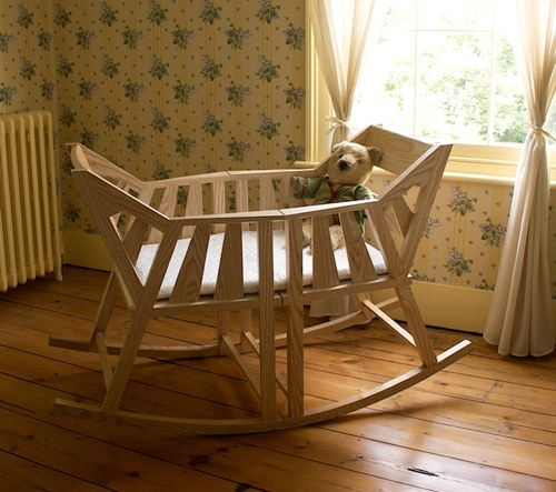 Baby's Rocking Cradle by UK-based designer Martin Price comes with a built-in second life: after the cradle has served its purpose, it can be sawn in half to create a pair of rocking chairs.