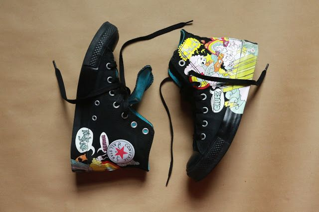 Cartoon comic motif black high tops Converse. Click to view more and buy.