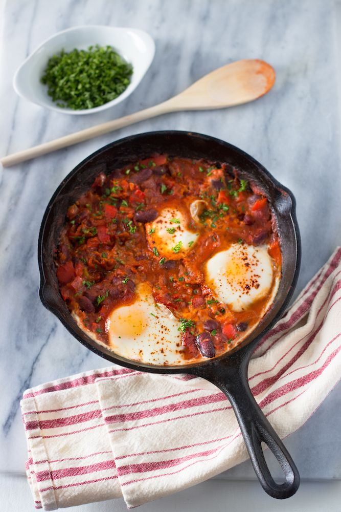 Shakshuka - eggs poached in rich tomato sauce along with some veggies and spices. Sound delicious, isn't it? And it's good for breakfast, lunch, and dinner.