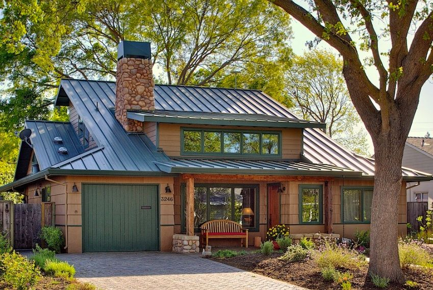 5 best ways to choose your roof colour metal roof green for Red brick house with metal roof