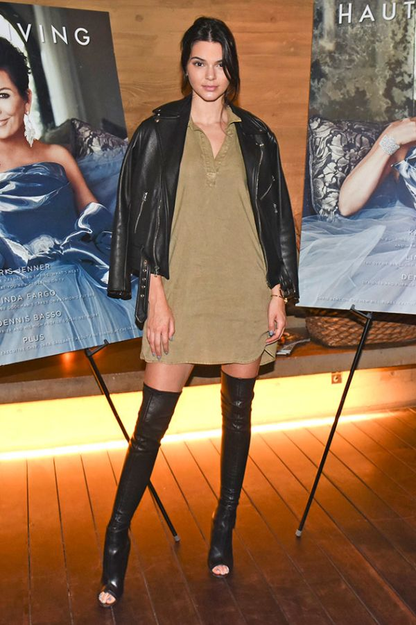 Rock over the knee boots like Kendall Jenner with a classic khaki mini  dress and black