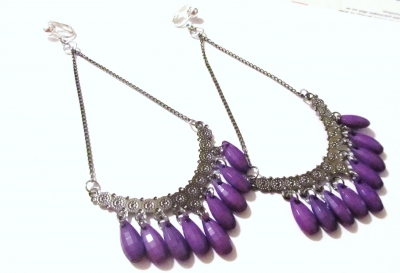 """These are a new pair of 5 1/2"""" Chained Half Moon Purple Beaded Dangle Clip-on Handcrafted Earrings, comfortable, lead free - spring clip-on's. They will never tarnish. They are very well made and sturdy fitting lightly to your ears. The clips are silver plated. The best way to clean these earrings are with jewelry cleaning and a polishing cloth.    If the buyer prefers, we will make these into pierced earrings. Just email us to let us know.    Please review the picture."""