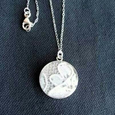 Put a piece of your wedding gown into a necklace. Your daughter can wear it on her wedding day (something old).