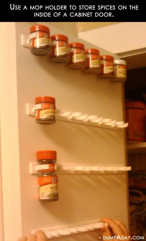 I really like this idea!  Looks like the spices would be so much easier to see and get to.  Mop holders for spice organization!!