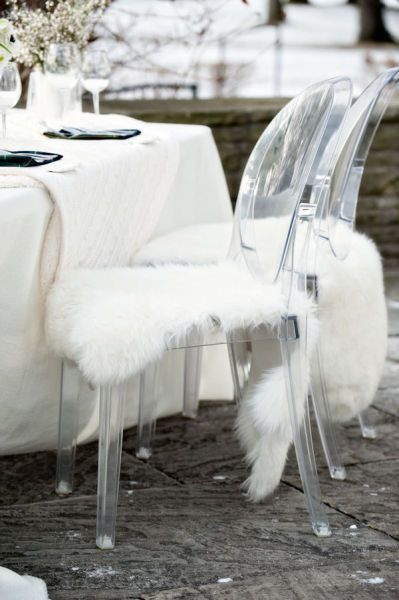 this idea of using faux fur and acrylic chairs to glam up the decor