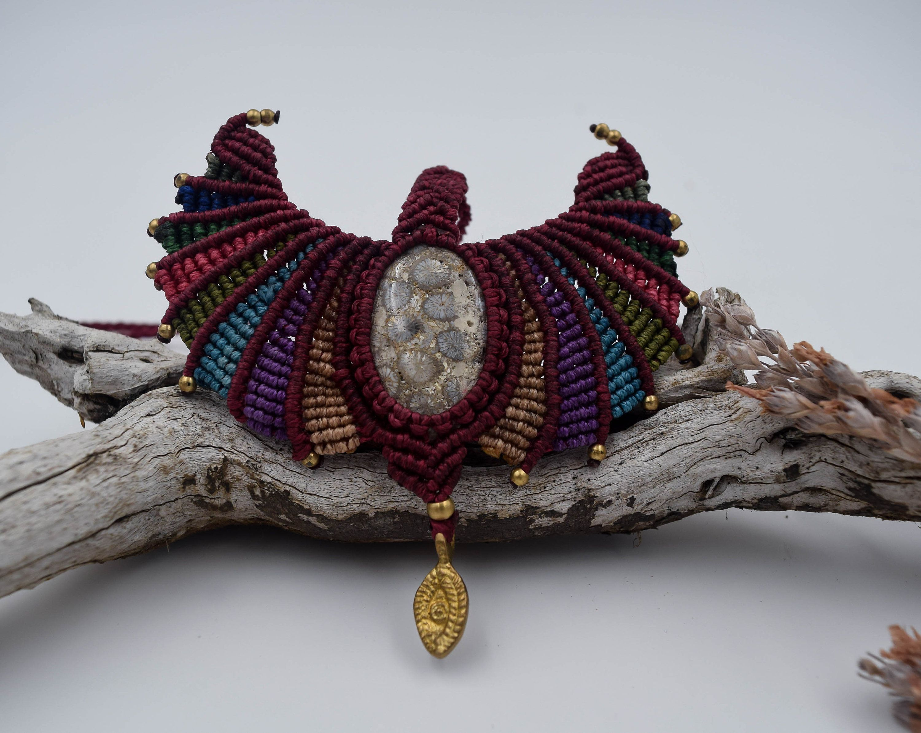 MACRAME NECKLACE WITH FOSSILS STONE This beautiful piece is made with macrame art jasper fossils, a protection stone. Its shape reminds open wings and the length is adjustable.  #BohoJewelry #ProtectionNecklace #BohemianNecklace #macrame #TigerEyeJewelry #wikandah #MacrameJewelry #HippieChic #MacrameNecklace #BohoNecklace