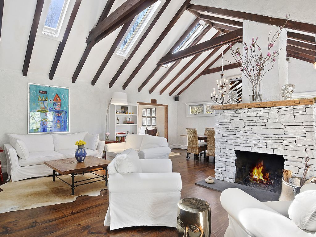 Stylish living room with vaulted ceiling | Intriguing.Interiors ...