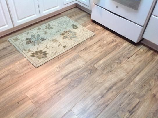 Trafficmaster lakeshore pecan 7 mm thick x 7 2 3 in wide for The pecan house