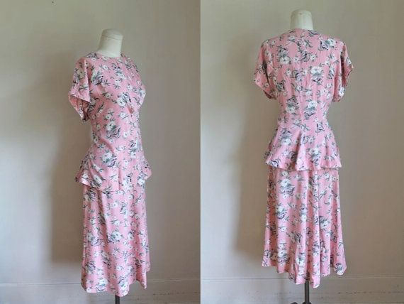 vintage 1930s cotton 2pc. dress set GIFTED PEONY pink novelty print by MsTips. This dress looks 1940's to me. The underbust seams, peplum, the slightly flared A-line skirt. The bodice fold- over closing similar to what was done in the 30's, only lower on bodice. Even the floral pattern resembles 1940's more. So if 1930's, this one was late decade. ALady