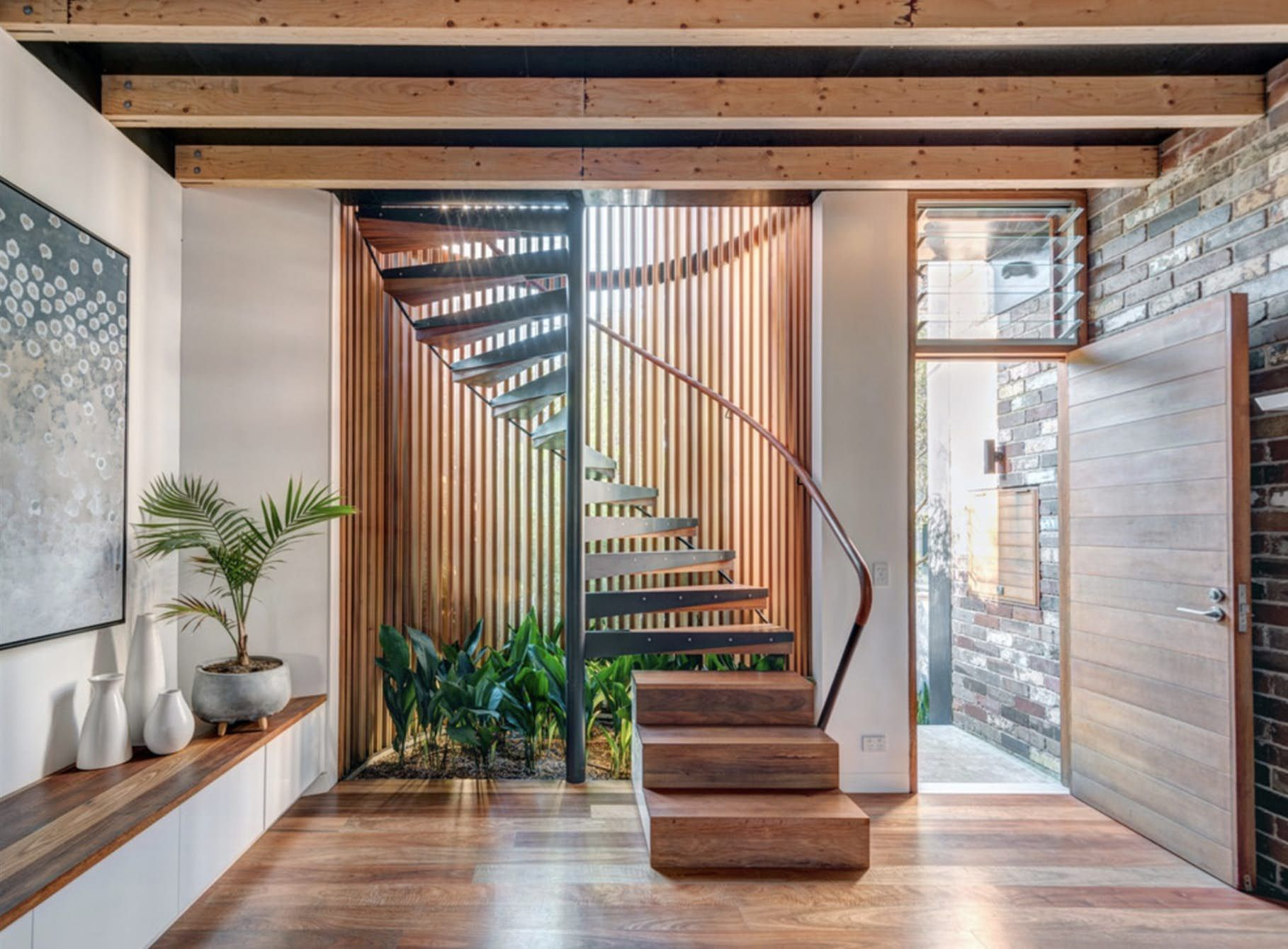 The Circular Glass And Timber Batten Staircase Doubles As A