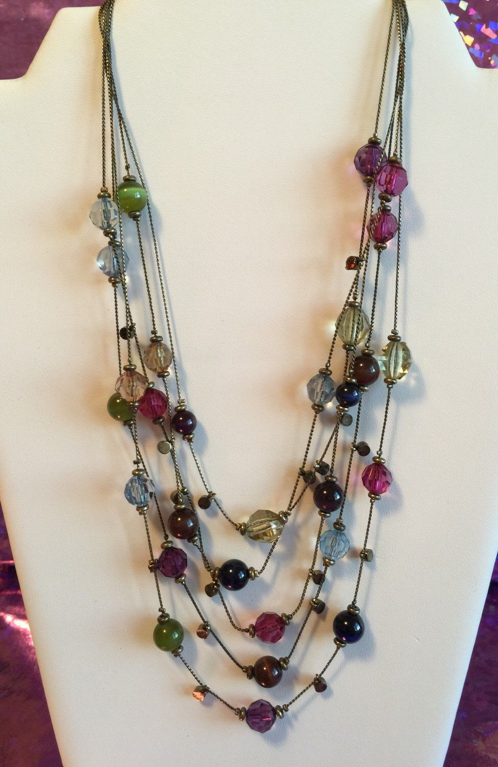 A personal favorite from my Etsy shop https://www.etsy.com/listing/276301728/colorful-tones-five-layer-necklace
