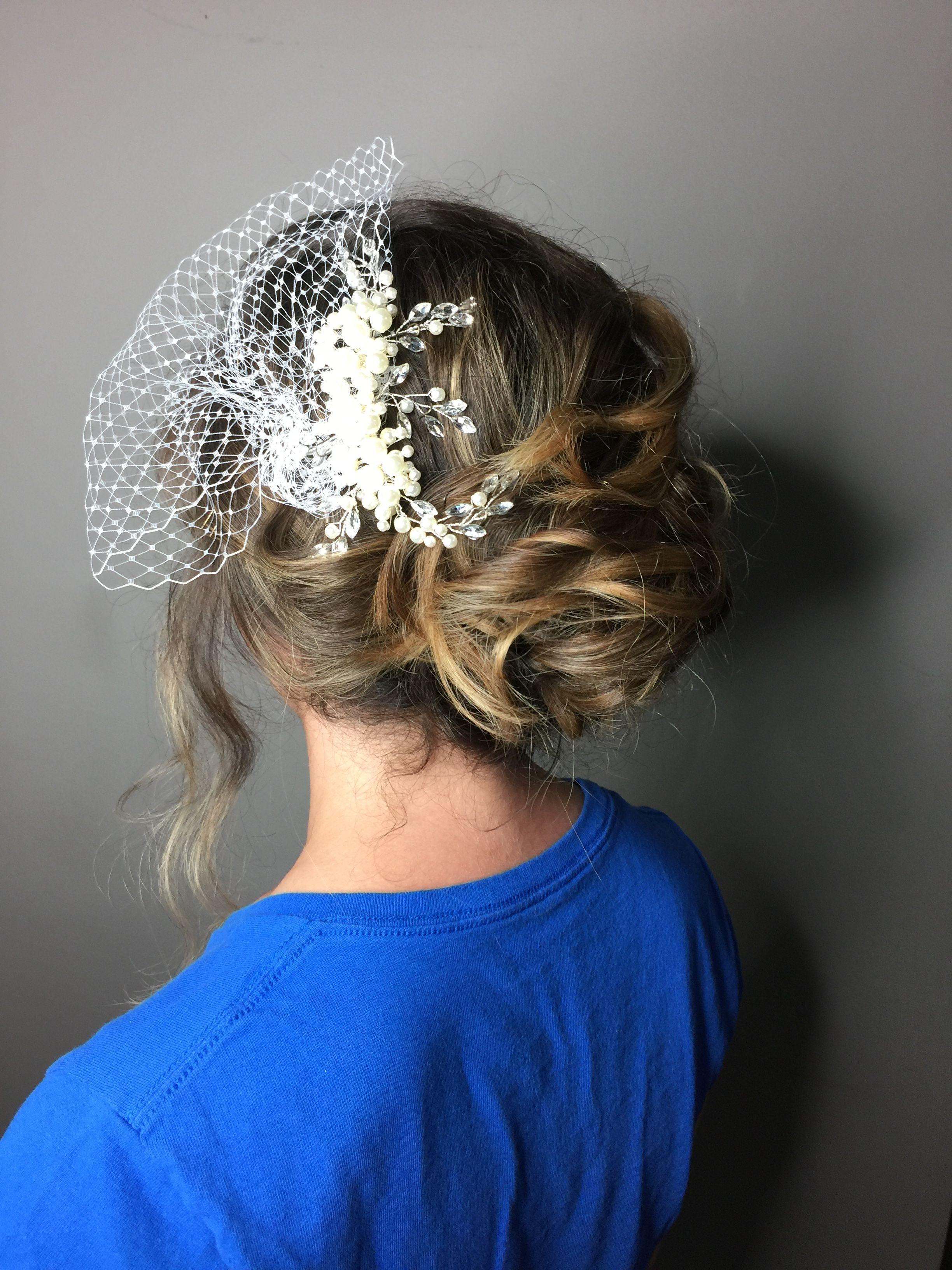Beach vintage hair inspired with birdcage wedding hair curly hair