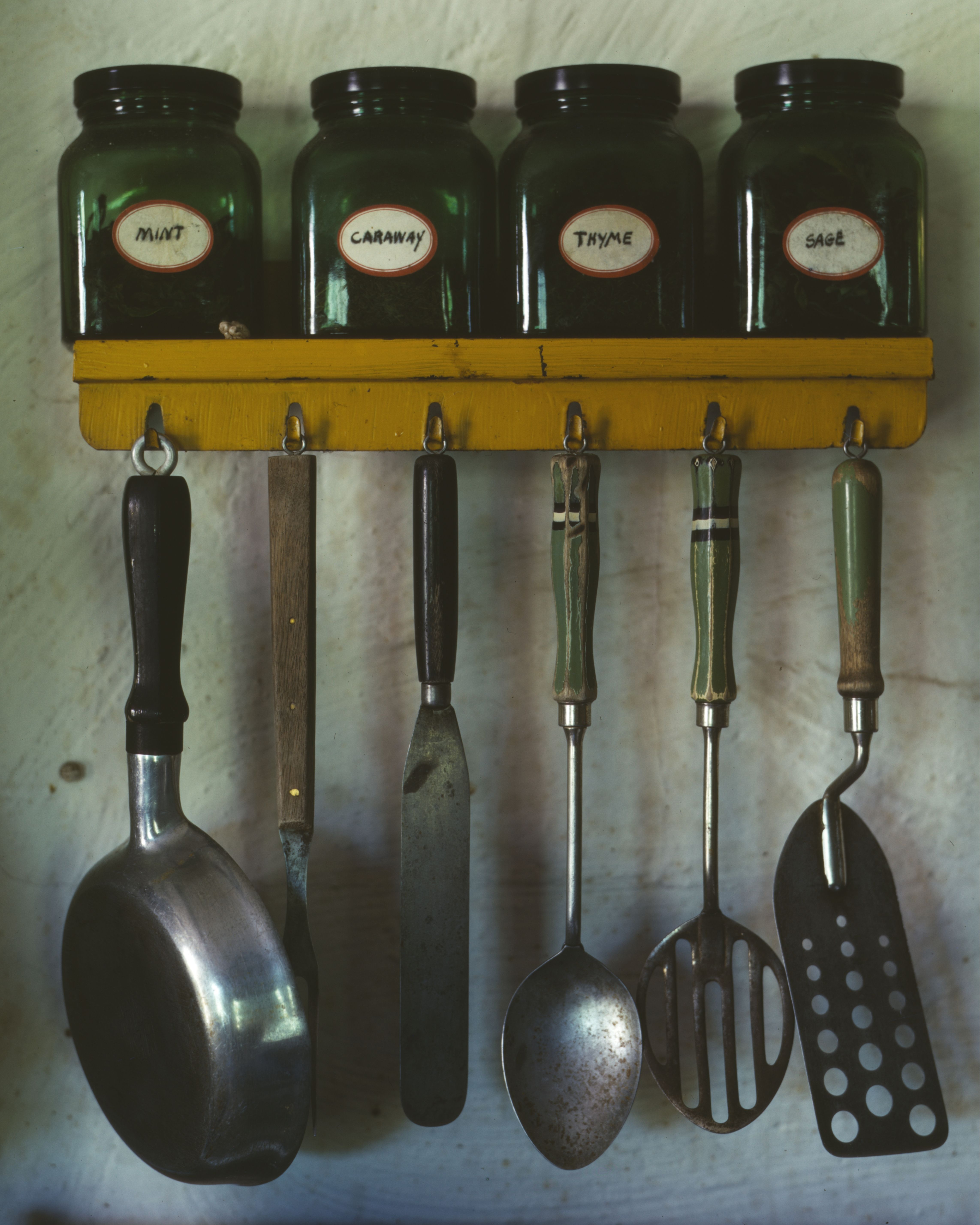 Kitchen Utensils Hanging Below A E Rack