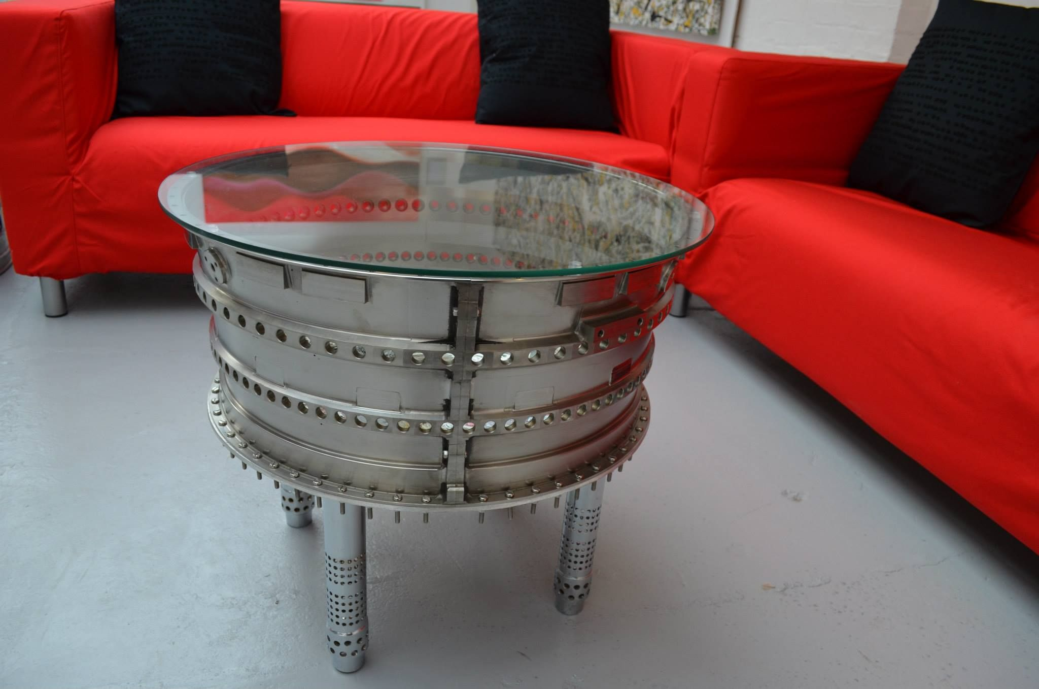 "Thrust"" coffee table made using a titanium jet engine insert out"