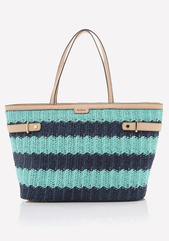 Seaside woven tote in vivid colorblock stripes. Wide-top design for effortless item storage and retrieval. Interior includes divided wall pocket.