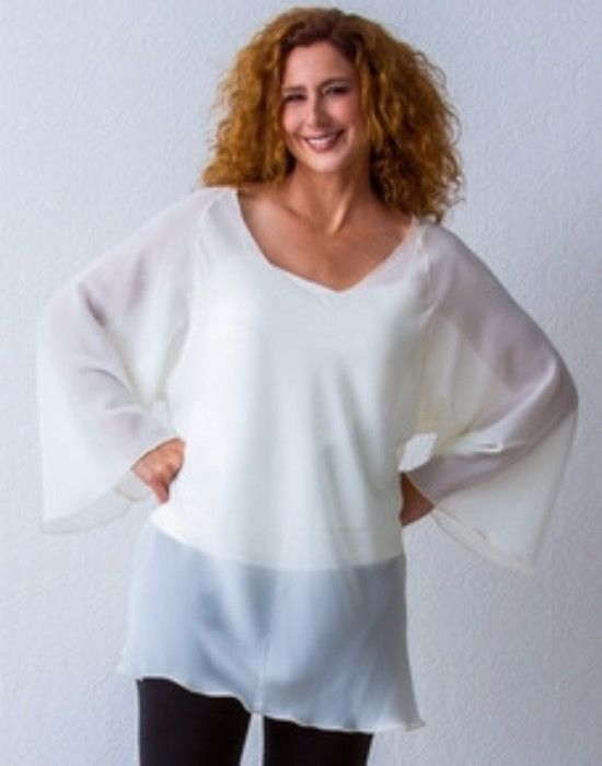 Long Sleeve Raglan Sheer Top •100% Poly Georgette •Machine Wash •Rolled hemming •V-neckline •Flared sleeve •Hits mid thigh •Wear with tank or camisole