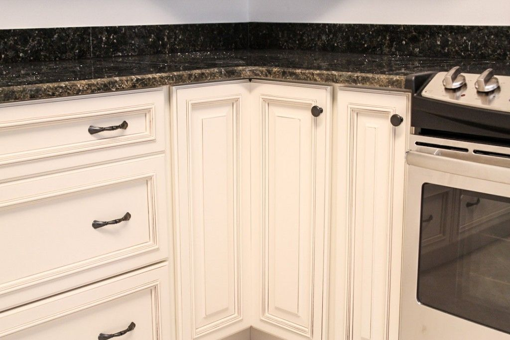 White Cabinetry With Dark Hardware, Knob On Lazy Susan
