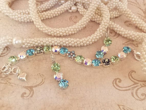 Flower bracelet swarovski 8mm blue green pastels abmothers swarovski crystal embellished bracelet shimmering blue green soft color spring negle Gallery