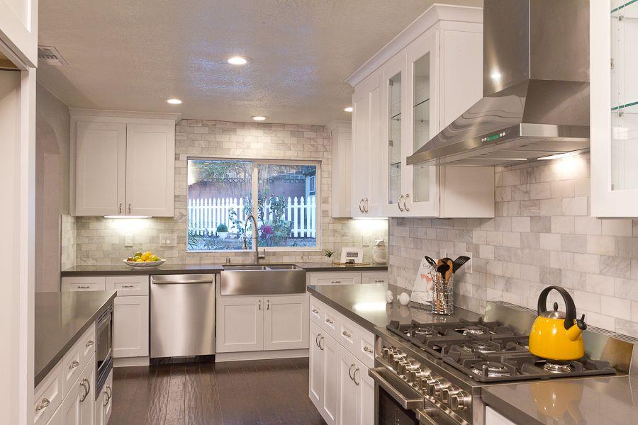 White Kitchen Shaker Cabinets Cemento Quartz Counters European