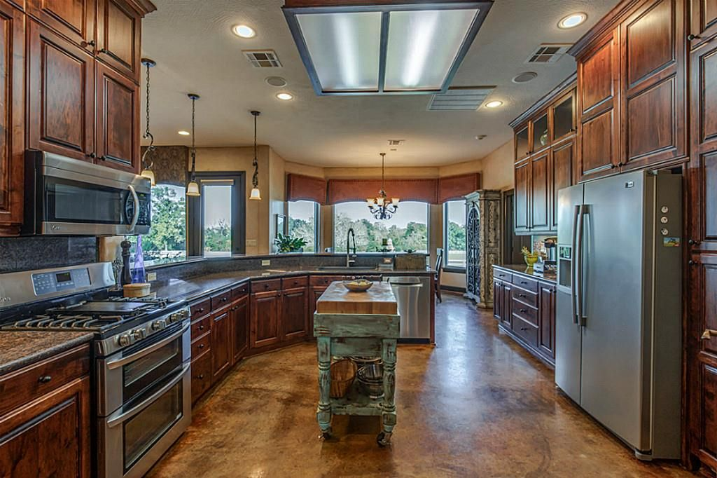 Chef's dream kitchen with custom maple cabinetry and ...