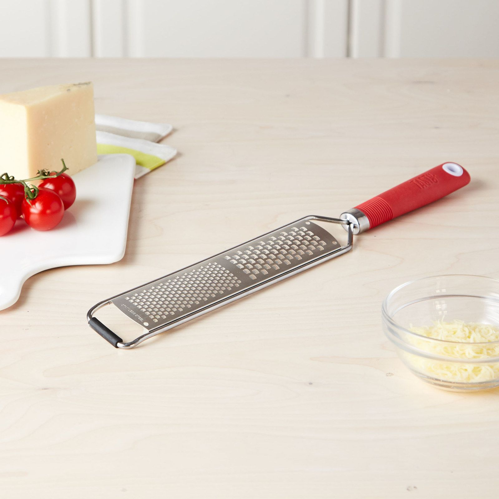 A handheld grater, so your friend can painlessly shred cheese, chocolate, or whatever else their heart desires with minimal effort.
