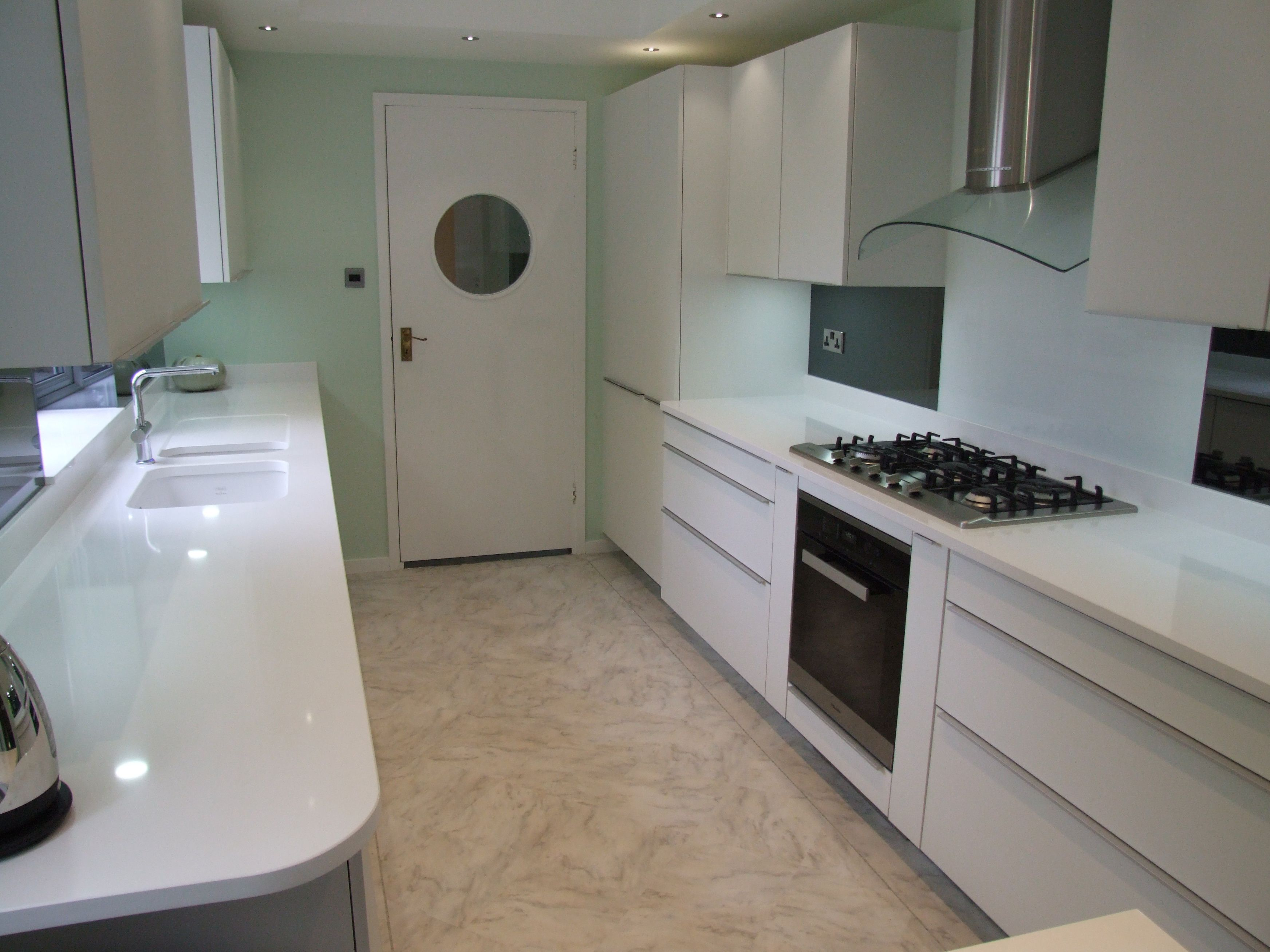 This galley kitchen features matt Polar White Poggenpohl units and ...