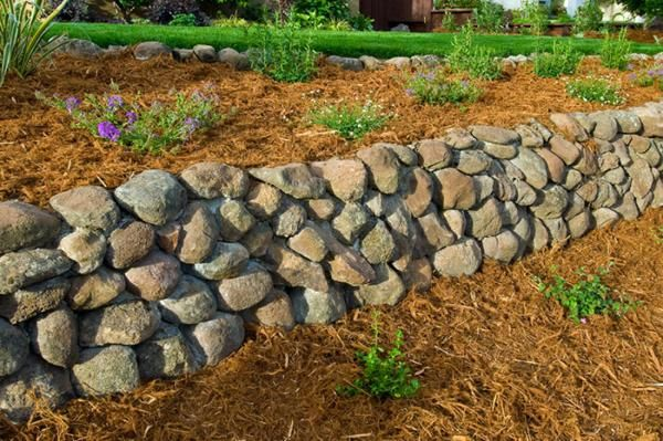 Using A Stone Wall In A Berm Landscaping With Rocks River Rock Landscaping Landscape