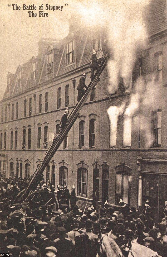 Firefighters tackle the blaze during the Siege of Sidney Street, Houndsditch, 1910. It broke out six hours into the siege, but Churchill refused them direct access, claiming he would wait for the criminals to flee. However the door never opened and two gang members, Fritz Svaars and William Sokolow, perished. Three policemen had already been shot dead.