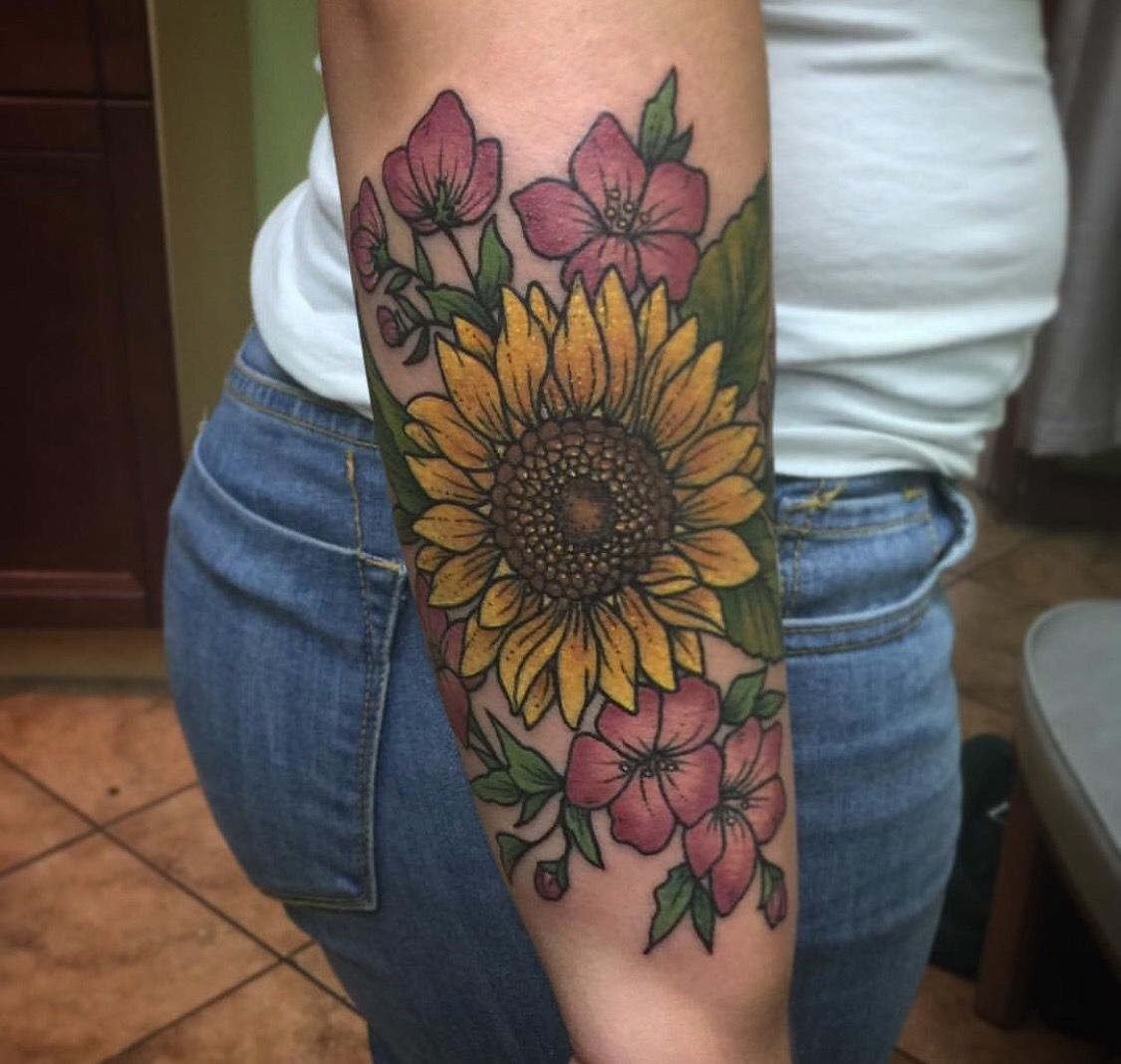 Photo of Loving the idea of this with primroses and violets surrounding the sunflower for…