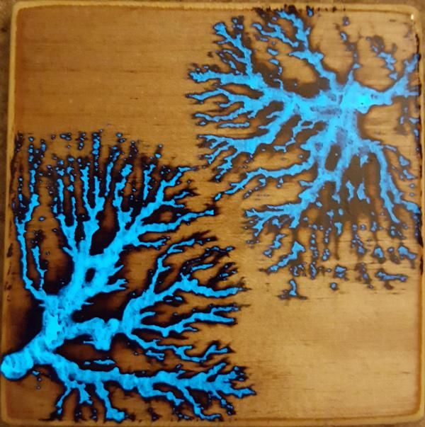 Glow In The Dark Patterns Burned Into Electrocuted Wood
