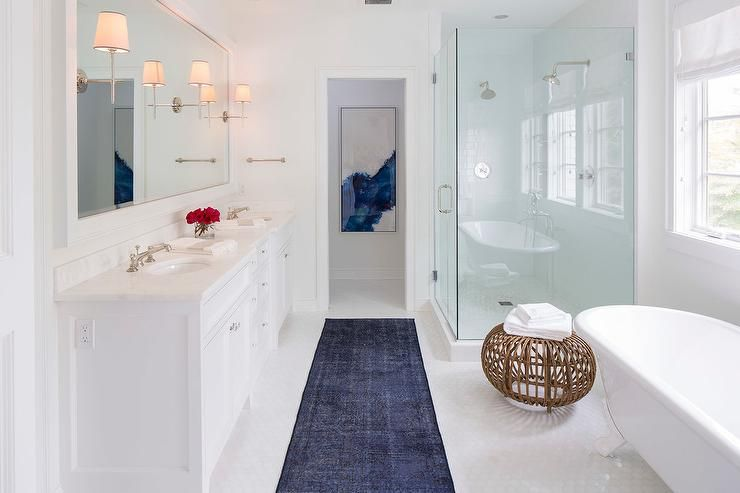 White Contemporary Bathroom With Blue Accents Features A Dark Overdyed Runner Placed On Glossy Hex Floor Tiles In Front Of Dual
