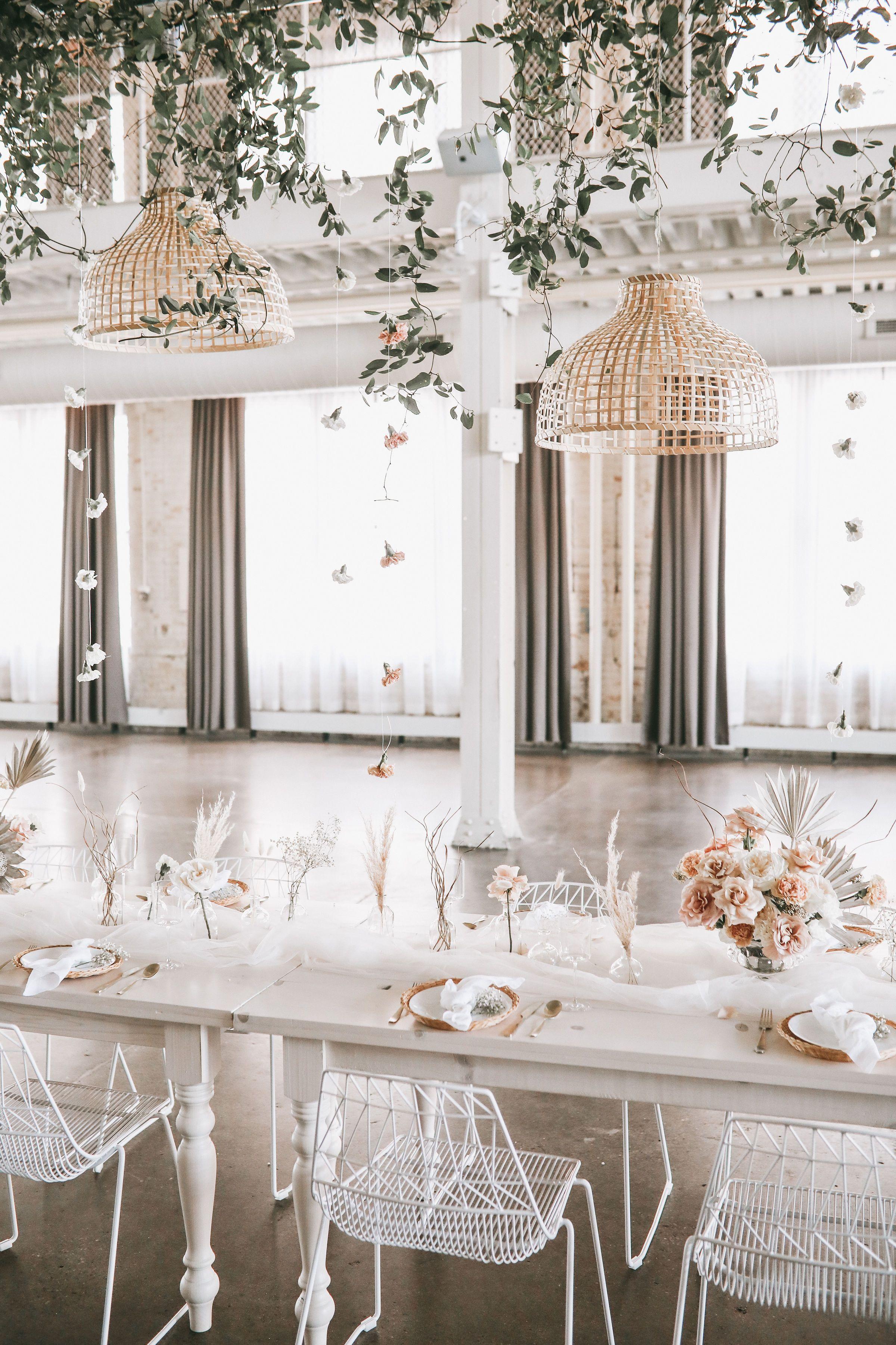 Modern bohemian wedding decor with whitewashed farm tables