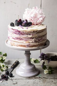 Four layers of light and fluffy vanilla cake with homemade blackberry lavender jam, and white chocolate buttercream. This Blackberry Lavender Naked Cake is nothing short of delicious. Every bite is layered with fresh berries, hints of lavender, and sweet vanilla cake!
