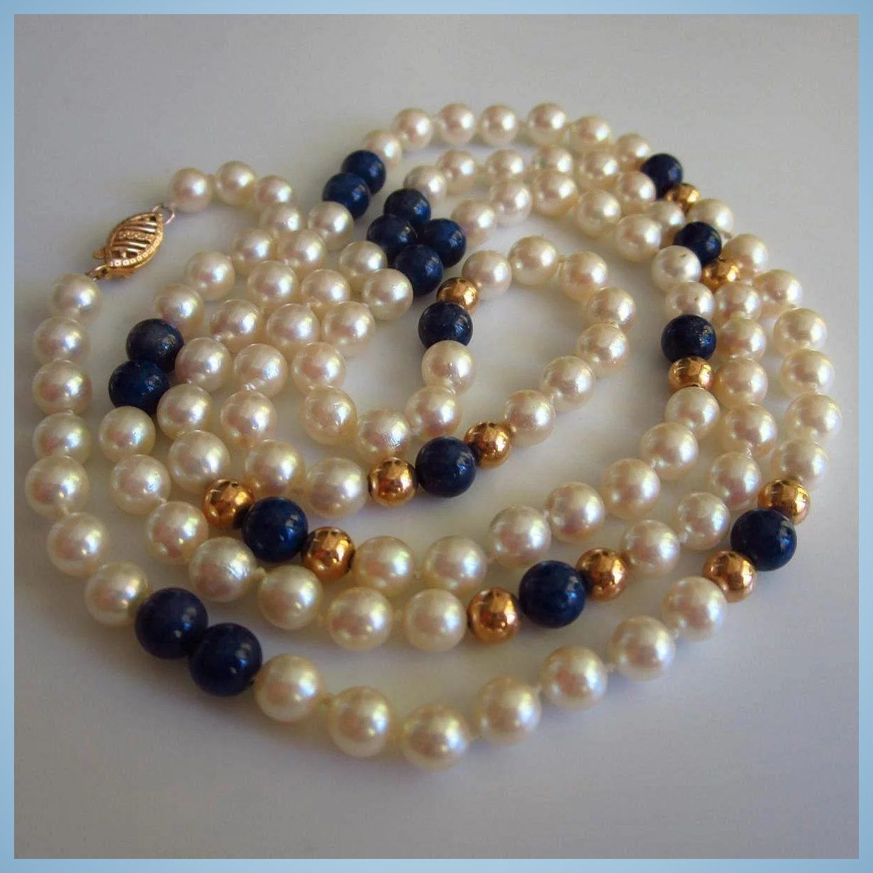 Classic long 14k gold spacers genuine cultured pearls