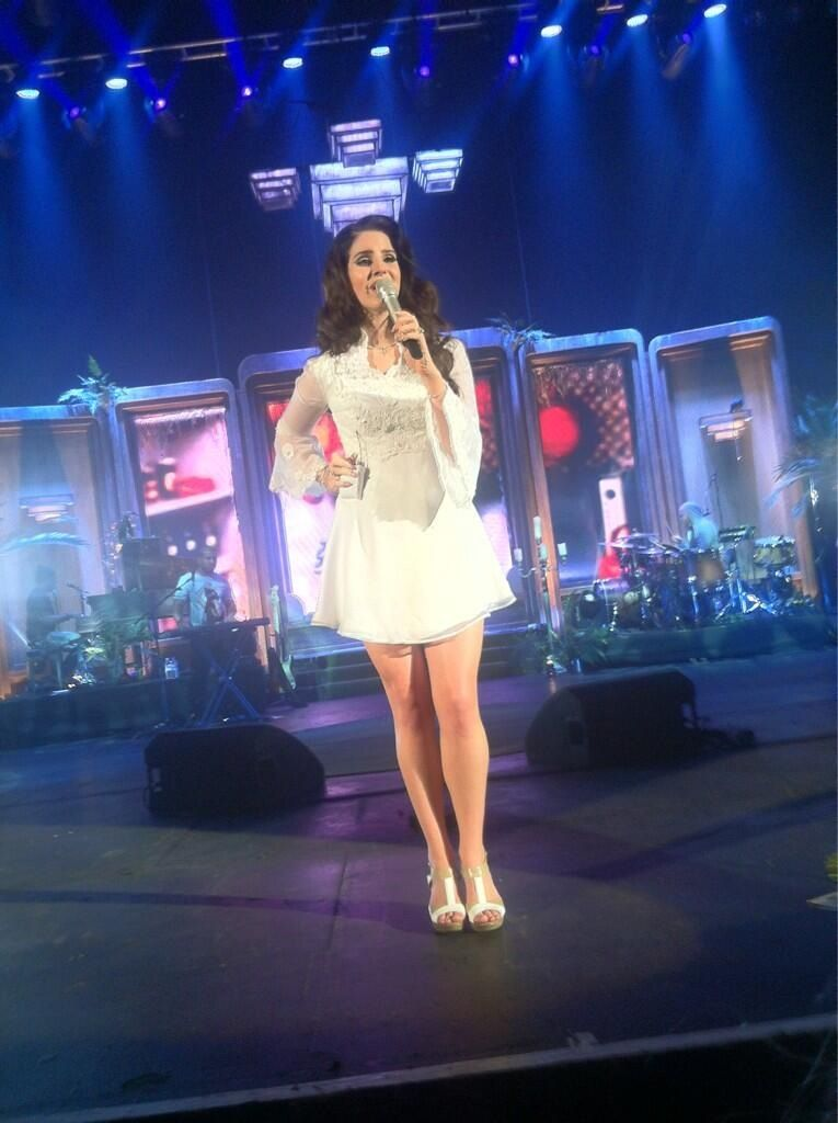 Lana Del Rey performs in a dated lace mini dress and