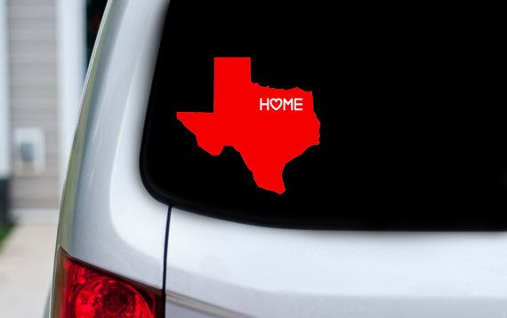 This is a t x w texas vinyl decal with the word home with a heart over your city