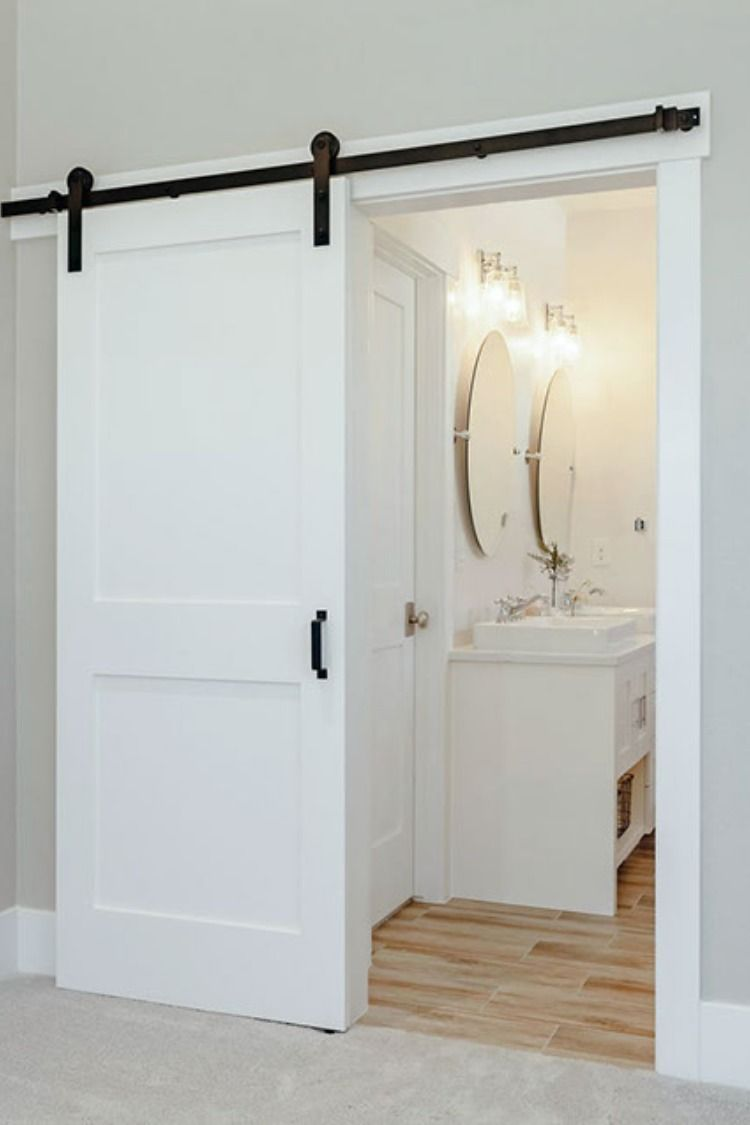 Brand New Bathroom With A Modern Sliding Barn Door Wood Look Tile And Gorgeous Finishes Modern Sliding Barn Door Modern Barn Door Sliding Bathroom Doors