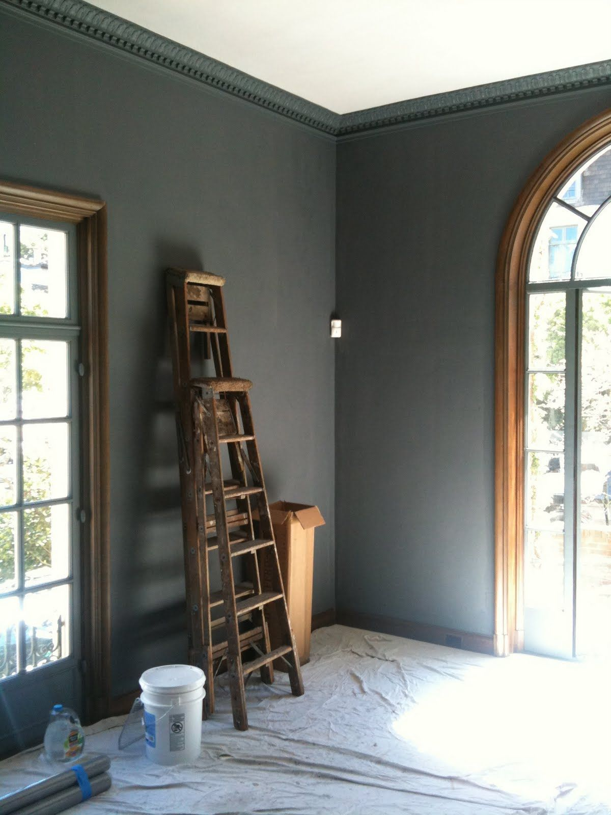 Crown molding painted the same color as the walls make